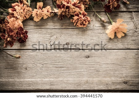 marigold on old wooden background - stock photo