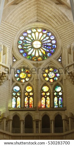 Marigold window from inside of the Sagrada Familia cathedral in Barcelona, Spain, July 2016