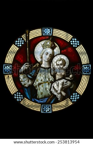MARIJA BISTRICA, CROATIA - JULY 14: Virgin Mary with baby Jesus, stained glass window in Basilica Assumption of the Virgin Mary in Marija Bistrica, Croatia, on July 14, 2014 - stock photo