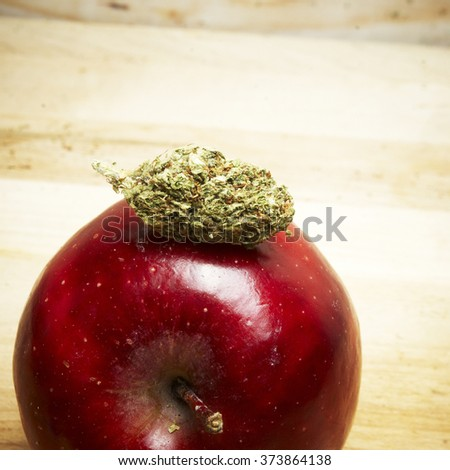 Marijuana and Cannabis and Red Apple - stock photo