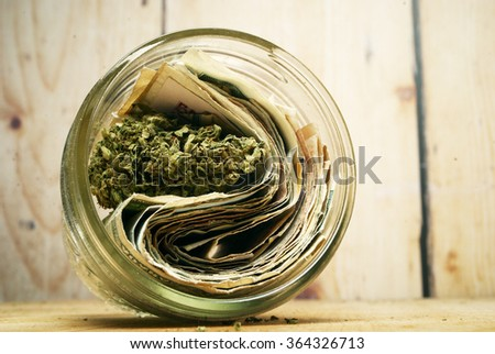 Marijuana and Cannabis Buds and Money, Drug Business American and Foreign Currency
