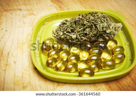 Marijuana and Cannabis in a Pill, Weed Capsules   - stock photo