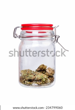 Marijuana and cannabis, jar of weed on white background - stock photo