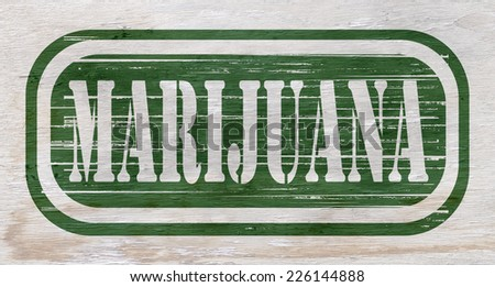 marijuana sign on wood grain texture - stock photo
