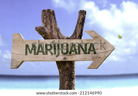 Marijuana wooden sign with a beach on background  - stock photo