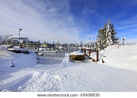 Marina and boat lounge in the snow on lake Tahoe - stock photo