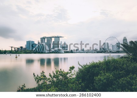 Marina Bay Sands, Gardens by the bay with cloud forest, flower dome, supertrees and the singapore flyer during daytime - stock photo
