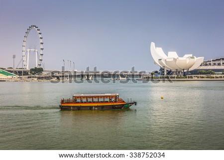 MARINA BAY SANDS, SINGAPORE NOVEMBER 05, 2015: Beautiful day at the Marina Bay waterfront, Singapore on November 05, 2015 - stock photo