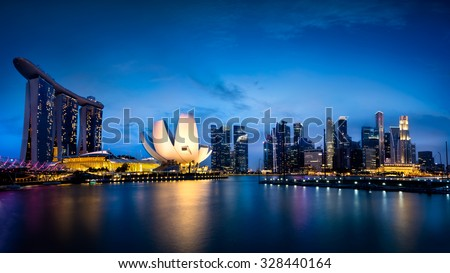 Marina bay Singapore at dusk - stock photo