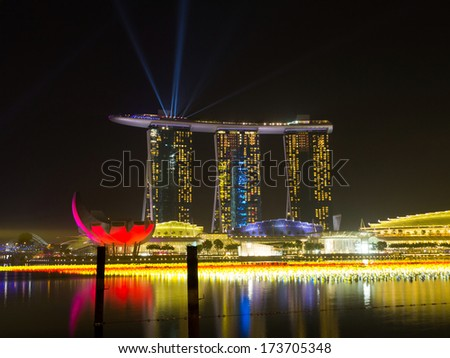 MARINA BAY, SINGAPORE - DEC 31, 2013: Night view of Marina Bay Sands Resort Hotel in Singapore. It is billed as the world's most expensive standalone casino property.  - stock photo