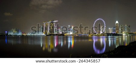 MARINA BAY, SINGAPORE-Mar 21: Twilight time of Marina Bay show of City Night light acitivity on March 16, 2015,City wonderful buildings in Singapore.