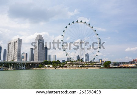 MARINA BAY, SINGAPORE - MARCH 01 2015: Singapore flyer is the most popular place to  see panorama view at Marina bay.  - stock photo