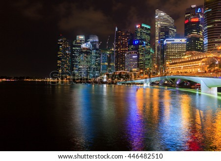 Marina bay,Singapore - March 27 , 2016 : view of Singapore city at night,lively and colorful light city that popular for tourist.Beautful modern and famouscity - stock photo