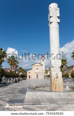 Marina di Carrara, Italy - 2017, September 26 : The Sacra Famiglia church and Sun Pillar in the Menconi square of the  town of Marina di Carrara in Tuscany, Italy