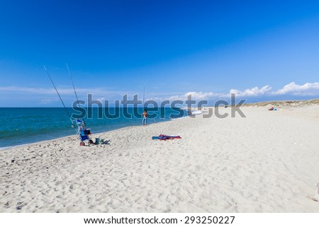 MARINA DI VECCHIANO, ITALY - OCTOBER 7: Fisher at the beach of Marina di Vecchiano near Pisa on October 7, 2009. The stretch of unspoilt public beach is a nature reserve of San Rossore Massaciuccoli.