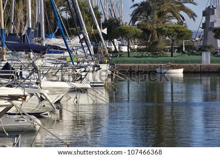 marina filled with yachts mooring - stock photo
