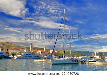 Marina of old Venetian town with sail boats tied to the pier, Trogir, Croatia - stock photo