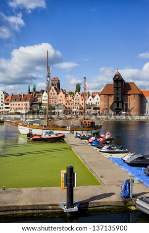 Marina on the Motlawa river and the Old Town of Gdansk skyline in Poland - stock photo