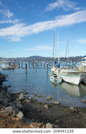 Marina picture with older boats in foreground shot in Sausalito, California. - stock photo