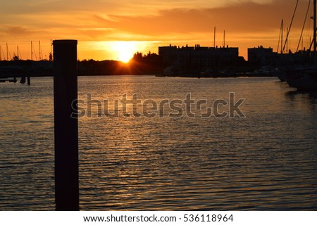 Marina Sunset with Sailboats and Yachts