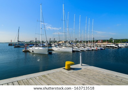 Marina with yacht boats and wooden pier Molo in Sopot town, Baltic Sea, Poland - stock photo