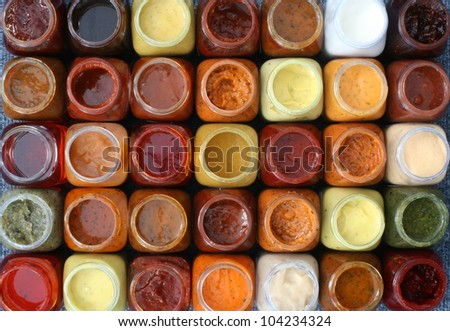 marinades and sauces in bottles, thirty-five pieces, top view with the cover open, isolated - stock photo