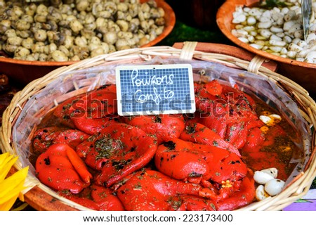 "Marinated baked peppers (""Poivrons confits"" in French), marinated champignons and garlic at food market in Paris. - stock photo"