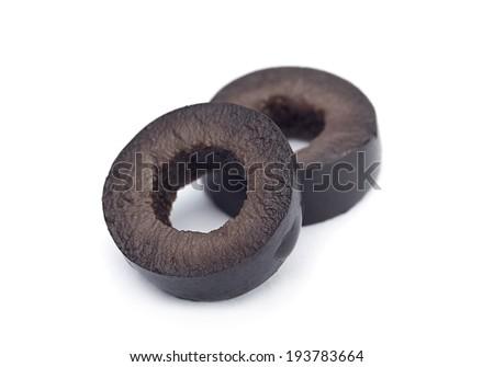 Marinated black olive closeup isolated on white background - stock photo
