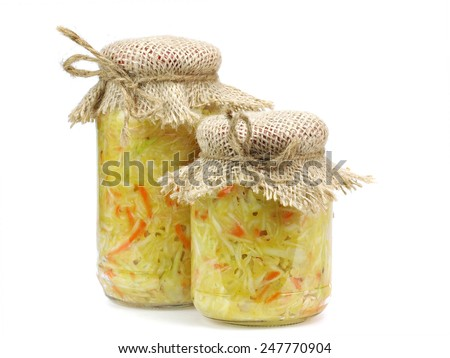 Marinated cabbage sauerkraut in glass jar on a white background   - stock photo