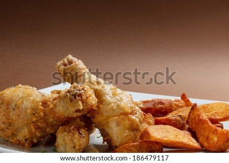 Marinated chicken legs with potato slices