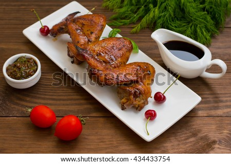 Marinated chicken wings in Japanese. On a wooden table. Close-up - stock photo