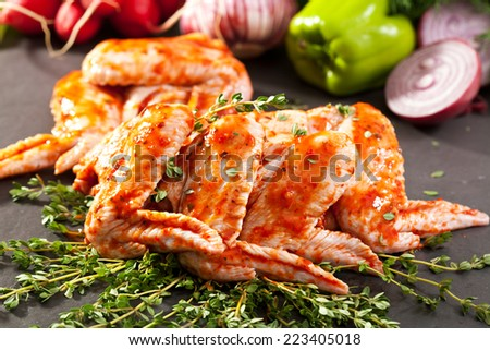 Marinated Chicken Wings on Thyme - stock photo