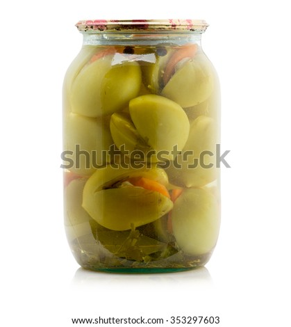 Marinated green tomatoes canned in glass jar isolated on the white background