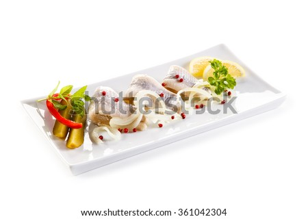 Marinated herring fillets on white background  - stock photo