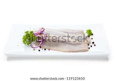 Marinated herring fillets with vegetables - stock photo