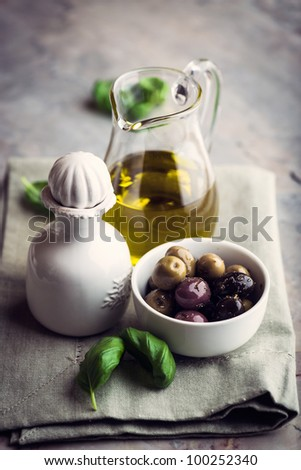 Marinated Olives and Olive Oil - stock photo