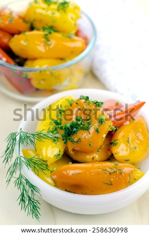 marinated peppers in white bowl - stock photo