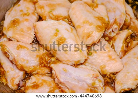 Marinated raw and fresh chicken wings for cooking ingredient for food background  - stock photo