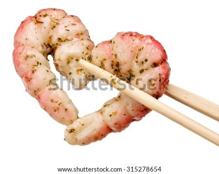 Marinated shrimps heart with chinese chopsticks - stock photo