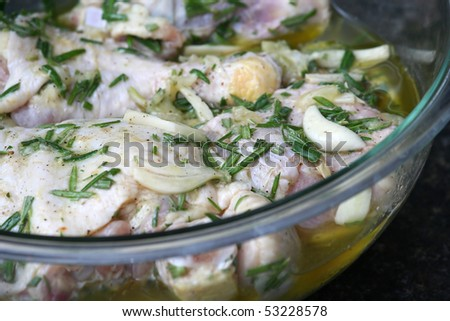 Marinating Lemon Chicken in a Clear Bowl - stock photo