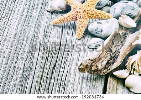 Marine background with pebbles and starfish  - stock photo