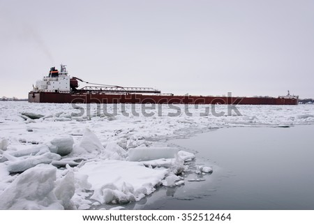 MARINE CITY, MI, USA /JANUARY 22, 2015: The JAMES R BARKER of the Interlake Steamship Company is down bound on the icy St Clair River at Marine City, MI on January 22, 2015.