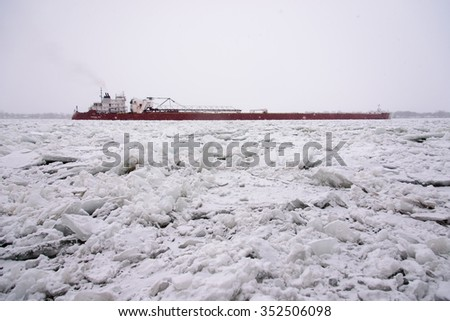MARINE CITY, MI,  USA / JANUARY 20, 2015: The PRESQUE ISLE is down bound in heavy snow and heavy ice at Marine City, MI on January 20, 2015, on the St Clair River.