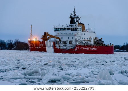 MARINE CITY, MI - USA - JANUARY 25, 2015: The USCG MACKINAW on January 25, 2015 working ice on the St Clair River at Marine City, MI. The Mackinaw is the largest ice breaker on the Great Lakes.