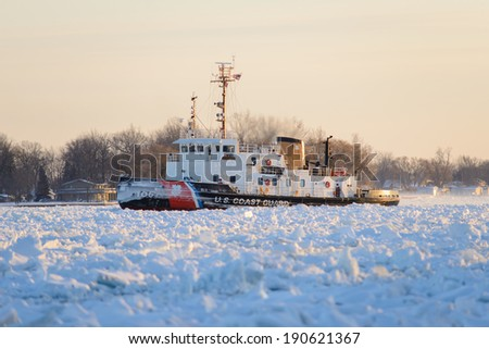MARINE CITY, MI - USA - ??JANUARY 8, 2014: The USCG NEAH BAY on January 8, 2014 working ice on the St Clair River at Marine City, MI. The NEAH BAY is a 140' tug with ice breaking capabilities.