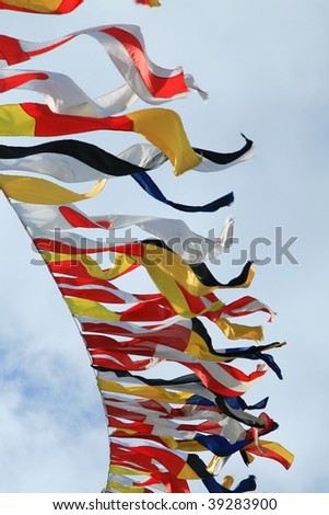 Marine colored signal flags against the sky - stock photo