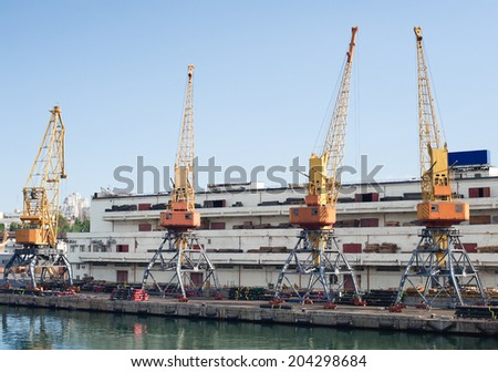 Marine cranes in the port for loading cargo. Dock at the seaport - stock photo