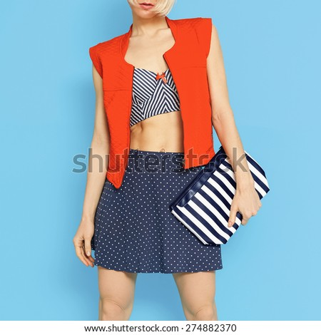 Marine fashion style. Glamorous Lady on blue background. - stock photo