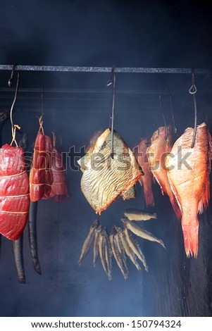 Marine fish from smokehouse is a great source of omega 3 and healthy life - stock photo