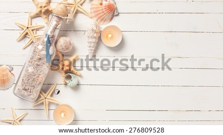 Marine items and candles on  white painted wooden background. Sea objects on white wooden planks. Selective focus. Place for text. Toned image. - stock photo